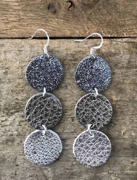 maureen-midnight-glitter-gunmetal-patent-leather-gunmetal-and-silver-leather-circle-drop-earrings