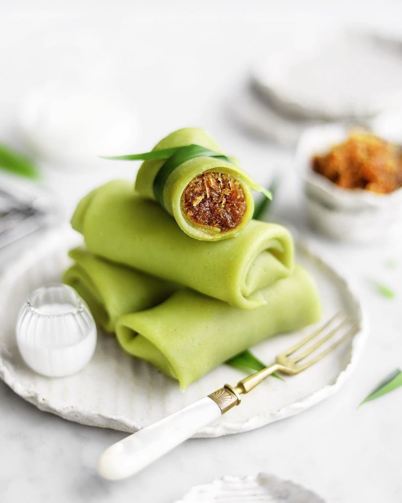 Pandan Rolled Crepes With Grated Coconut