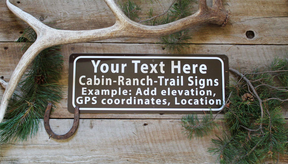 custom cabin metal sign with brown background and white text