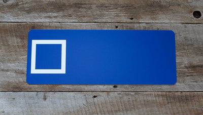 custom blue square ski sign with a blue background and white text