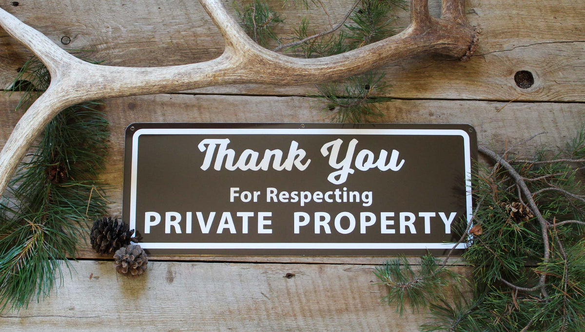 metal sign that says 'thank you for respecting private property' in white text with a brown background