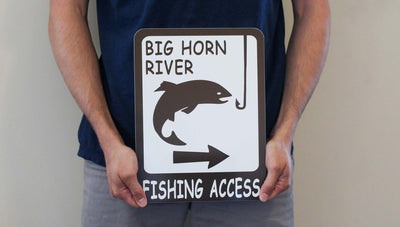 man holding a customizable brown and white metal fishing access sign