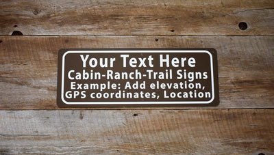 custom forest service style sign with white text and brown background on a wood background