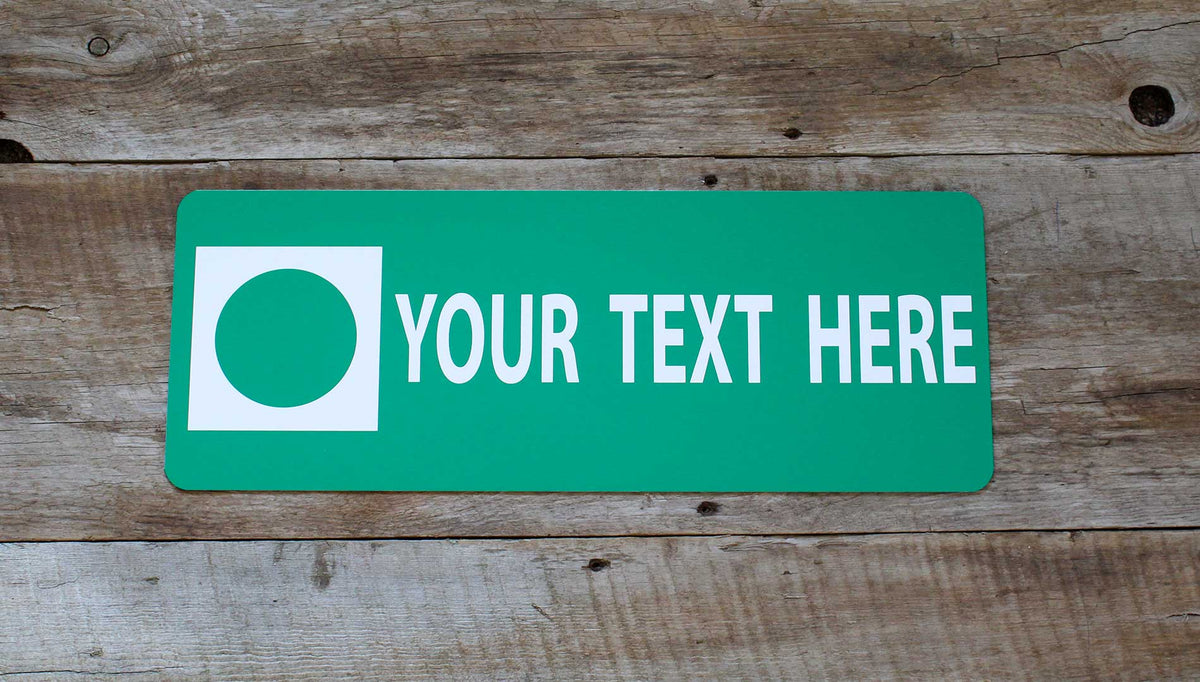 a custom metal green ski run sign with a green background and white text that says 'Your Text Here' on a wooden background