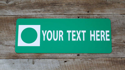 a custom metal green ski run sign with a green background and white text that says 'Your Text Here'