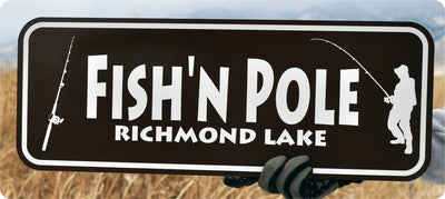 metal sign with white text that says 'fish'n pole' on a brown background