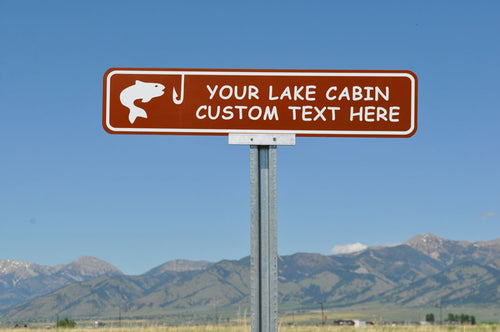 custom lake cabin sign with a brown background and white text that says 'your lake cabin custom text here' with an image of a fish and hook in white