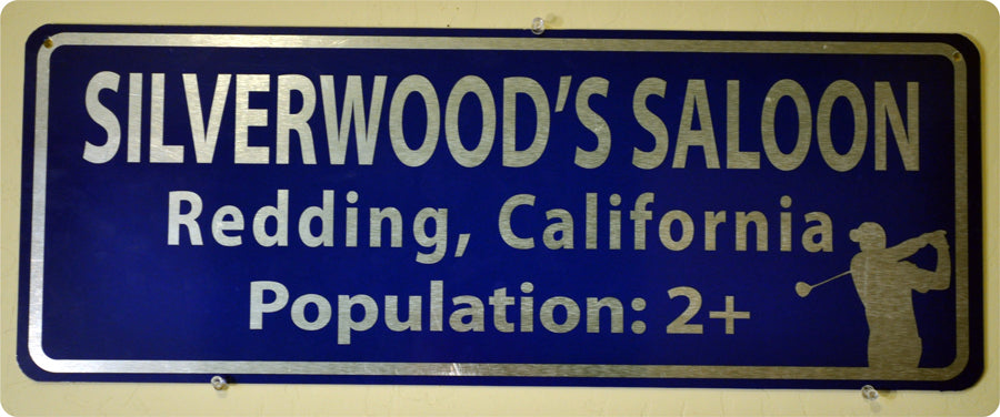 metal sign with white text that says 'silverwood's saloon' on a blue background
