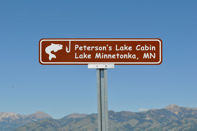 lake cabin sign with a brown background and white text that says 'Peterson's Lake Cabin Lake Minnetonka, MN'