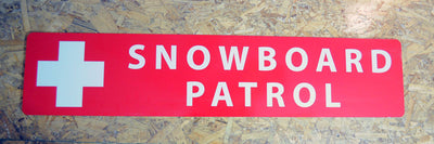 a metal snowboard patrol sign with a red background and white text that reads 'Snowboard Patrol'