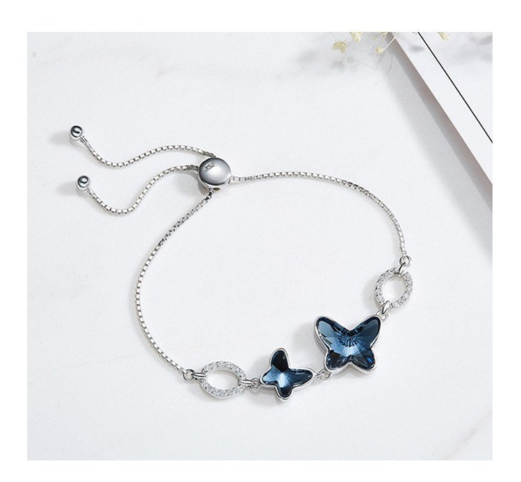 Adjustable Double Butterfly Pendants Bracelet S925 Sterling Silver. Crystals from Swarovski .