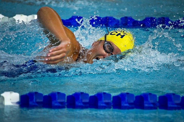 professional swimmer using ear plugs