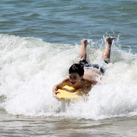 boy using body board bag