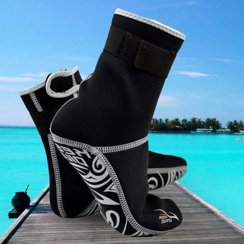 dive booties on tropical beach