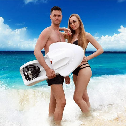 couple with electric surfboards