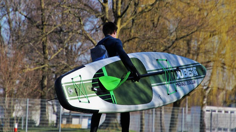 man carries inflatable sup