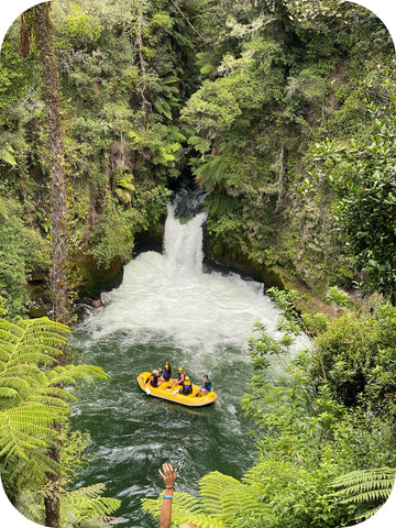 group rafting on white water river