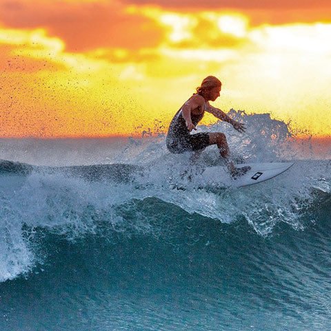 surfing sunset using wax