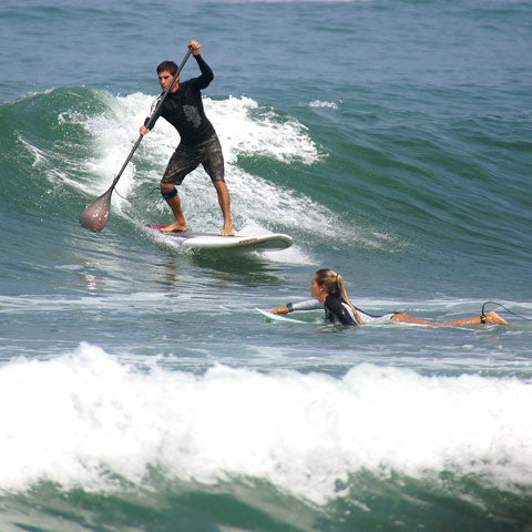 surf paddle board traction pads in use