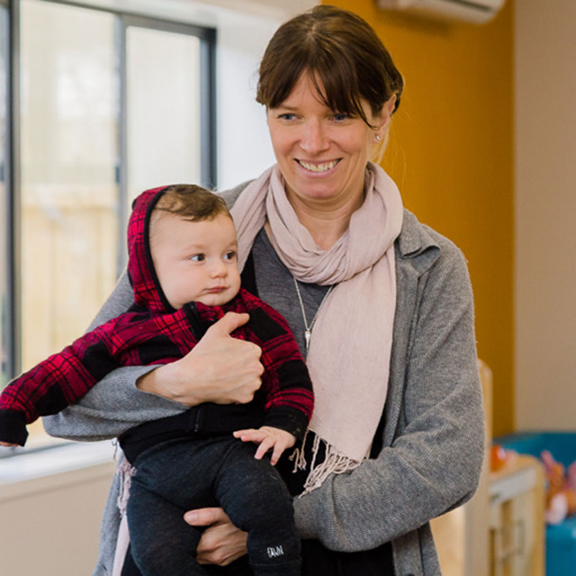 A teacher and a baby at Spotted Frog Preschool