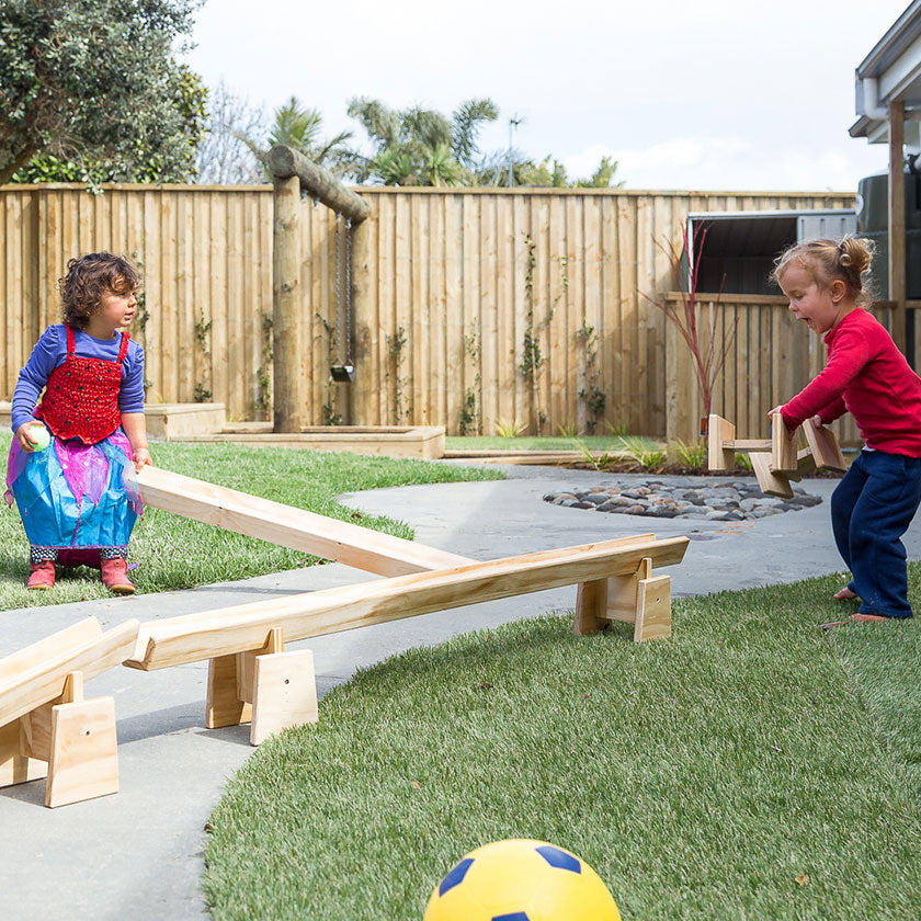 Two kids playing outside at Spotted Frog Preschool