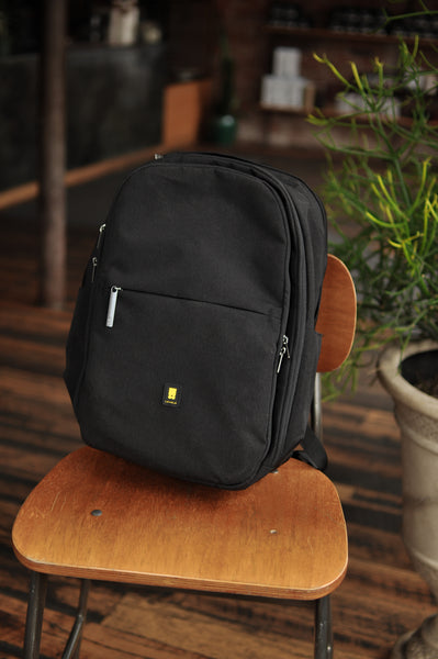 Atlas pro laptop backpack on the chair