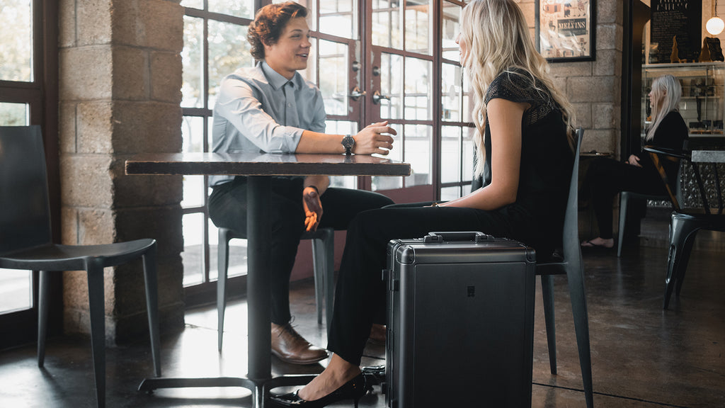 Business casual talking with LEVEL8 Gibraltar Alluminum Luggage