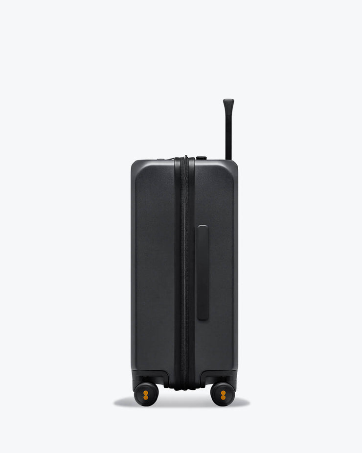 grey carry on suitcase with laptop pocket