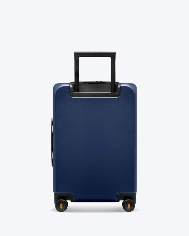 blue carry on suitcase with laptop pocket backside