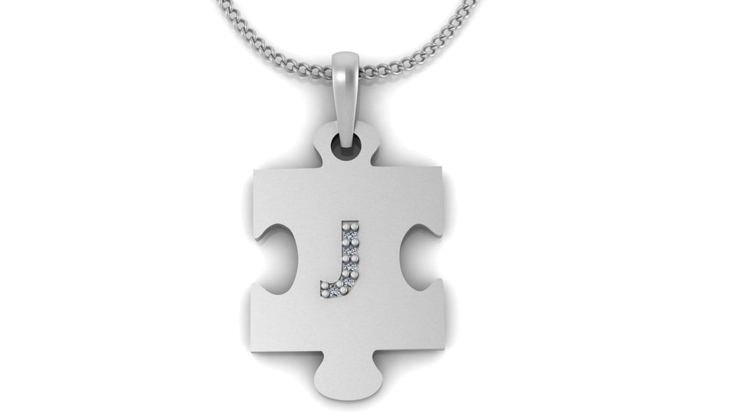 Image of a silver pendant in the shape of a puzzle piece with the letter 'J' in the middle