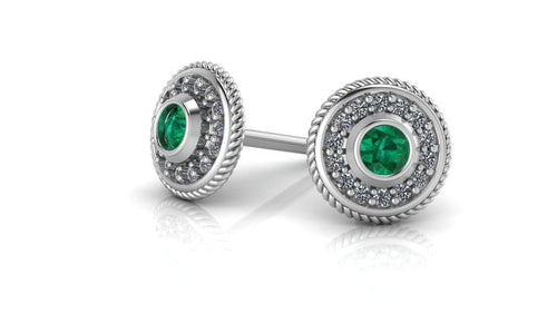 Image of two sterling silver studs with a green birthstone in the middle