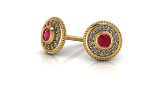 Image of two 14k gold studs with a ruby birthstone in the middle with diamonds encrusted around it