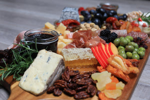 charcuterie board with local honey, fruit, cheese, olives