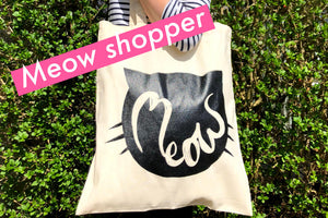 Image of a canvas tote bag featuring a bold illustration of the word meow
