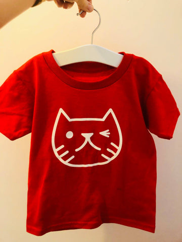Winking cat face kids T-shirt in Red