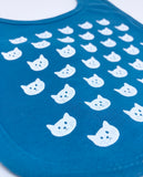 Image of a blue bib with a modern white cat pattern