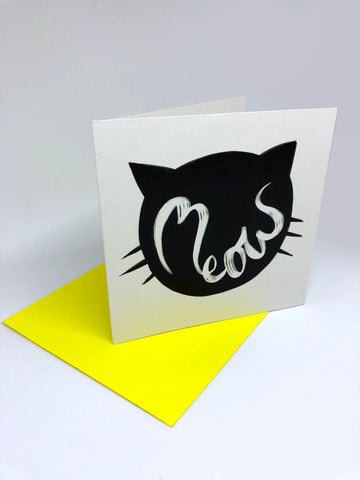An image of an illustrated greetings card which says the word meow