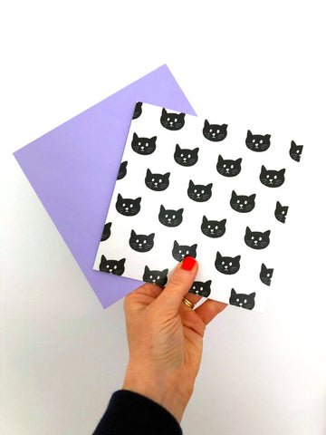 Image of an illustrated greetings card with a cat face pattern
