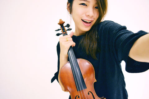 Asian woman holding a violin