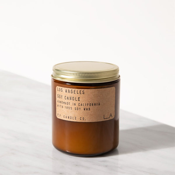 PF Candle Co Europe Los Angeles scented soy wax candle in an amber jar with a kraft label and brass lid