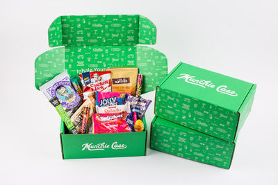 candy, chocolate, snacks that are inside of a munchie case subscription box