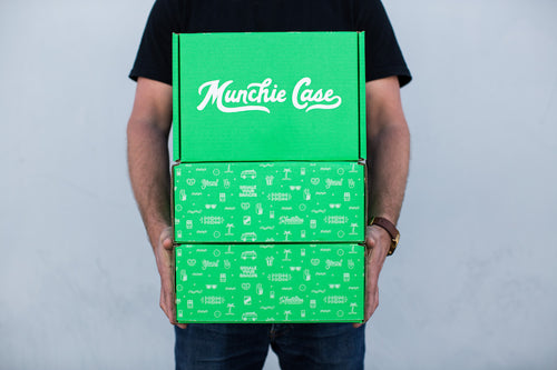 Subscriber holding delivery of snack subscription box munchie case