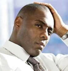 Idris Alba clean shaven with natural skincare products for black men in online shave clubs and with razor subscriptions