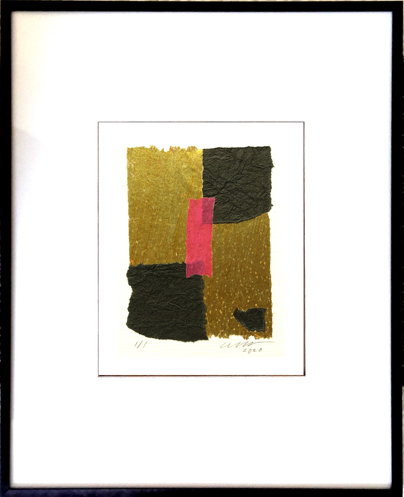 "The gold-tone, and black textured papers feature a centered hot pink accent. Black Metal Frame 13"" x 18"""