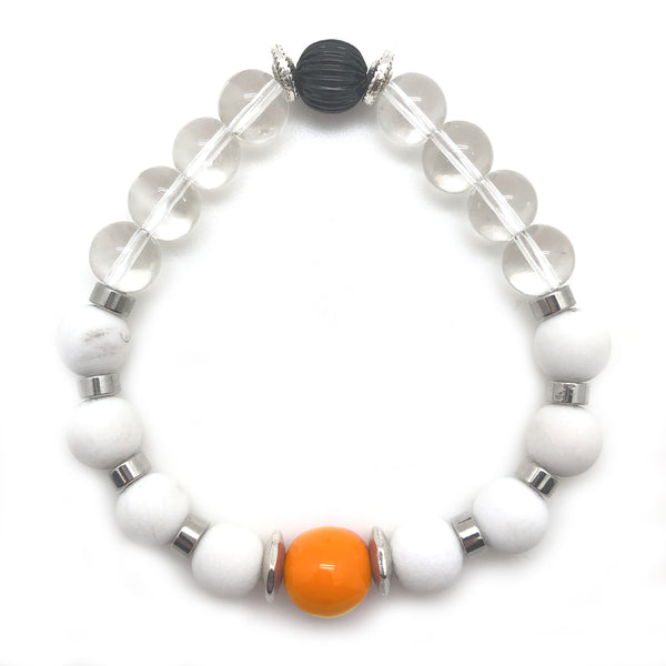 The Lucy Bracelet by MancessoriesUSA features a Genuine Lucite® Orange center bead surrounded by White Agate Alabaster and Clear Glass Beads.