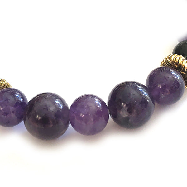 Aquarius Bracelet by MancessoriesUSA features Amethyst and Black Onyx semiprecious stones and Antique Gold Finished accents.