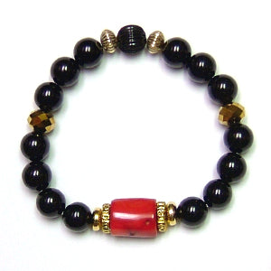The Explorer Bracelet features red coral, black onyx, 14/20 gold plated rondelles and faceted golden quartz.