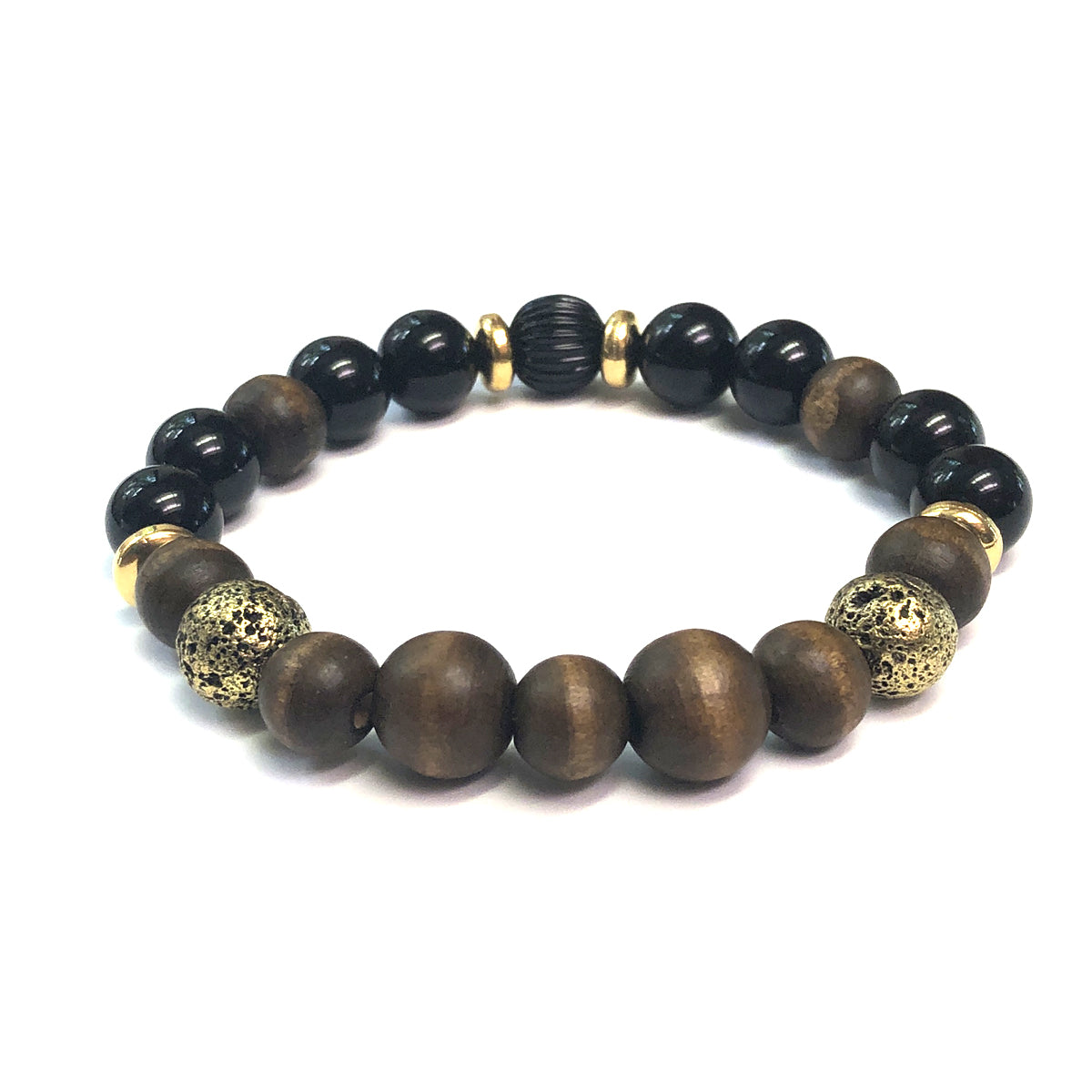 The Woody Bracelet by Mancessories features Warm Brown Wooden Beads, Antique Gold Finished Lava and Black Onyx Beads.