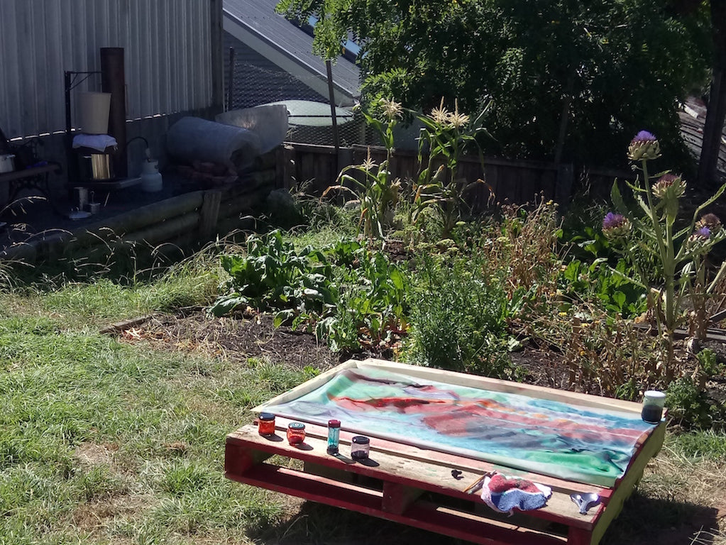 Space and light - backyard dyeing setup on a wooden pallet with the steamer heating up in the background
