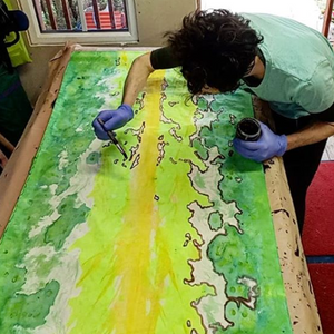 Textile acid dyeing artist Ian Jermyn painting the fabric by Organic Devolution